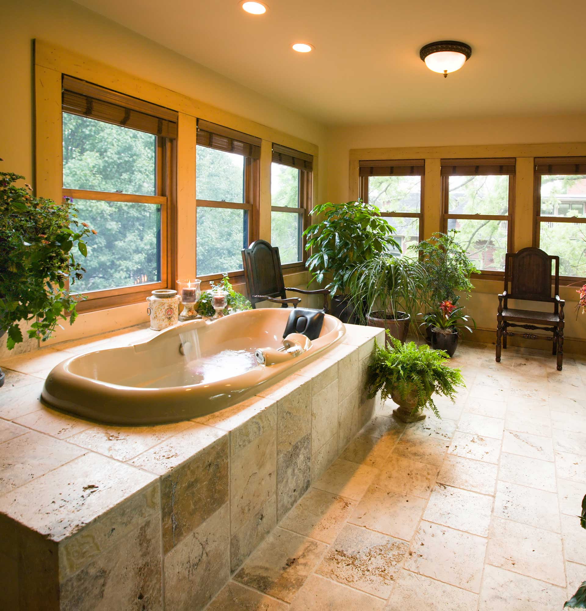 Luxury bath in Cloisters Suite at Inn on Montford in Asheville, NC. A spa room with multi-jet two-person Whirlpool with shiatsu massage, airbath, fireplace, and heated marble floors.