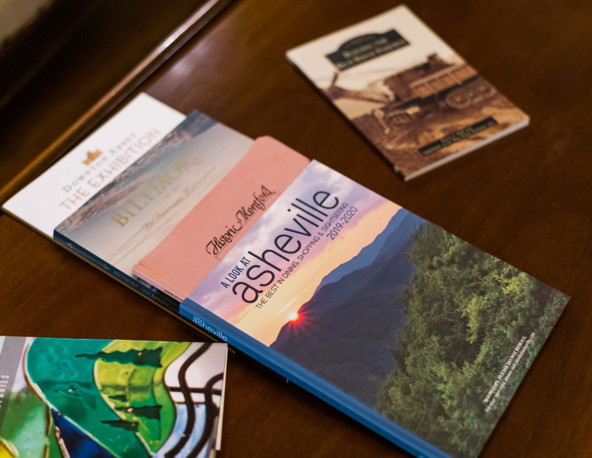 A close-up of an array of guides around Asheville at guests' disposal for unfogettable Asheville getaways.