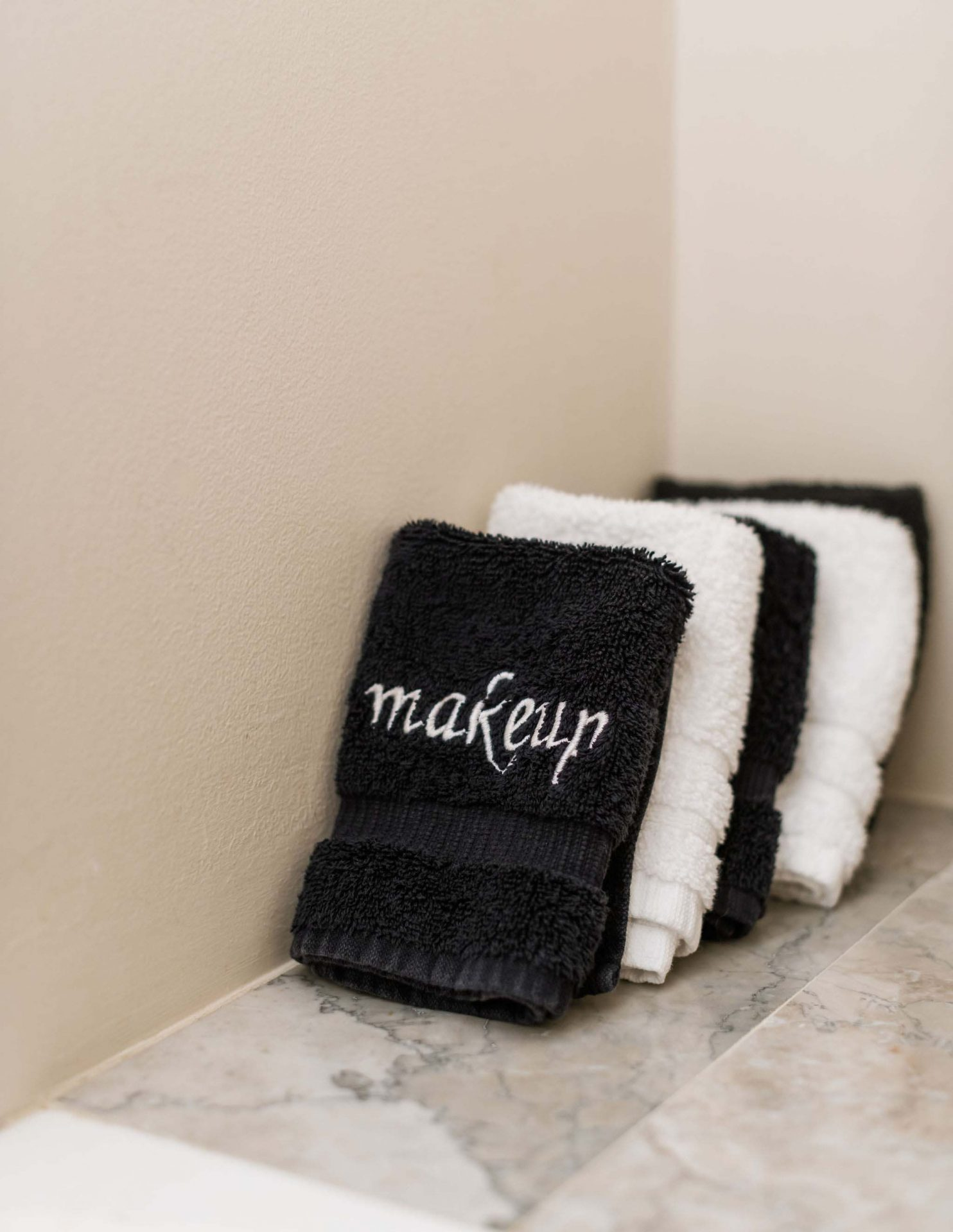 Five black and white make up removal towels arranged in one of the private bathrooms at Inn on Montford.